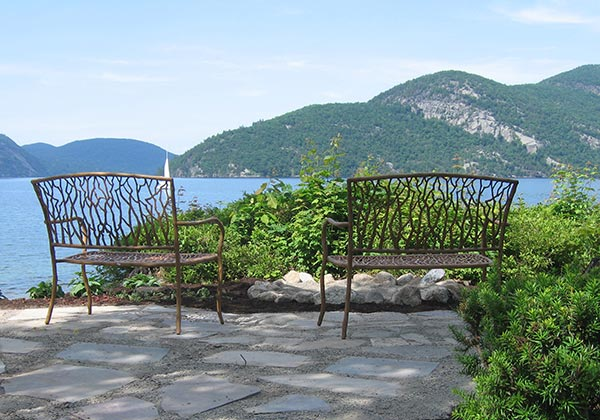 Decorative benches overlooking Adirondack Mountains and Lake George