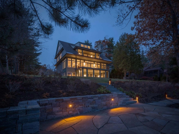 stone wall and patio down stairs from house at night