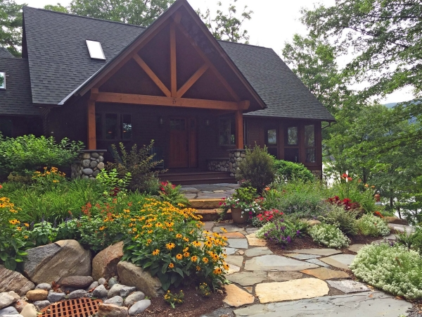 Lake home with stone walkway and landscaping