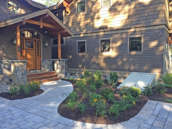 Home entrance with stone walkway and landscaping