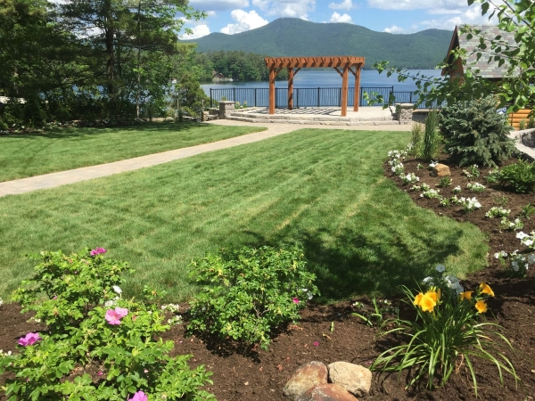 Landscaped grass and yard overlooking lake george