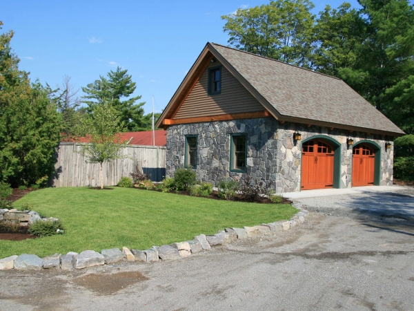 Stone garage with landscaped yard