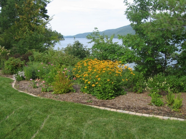 Landscaped yard overlooking lake
