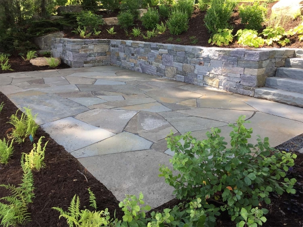 Stone patio and stone wall