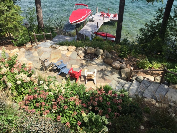 stone stairs leading down to dock and patio