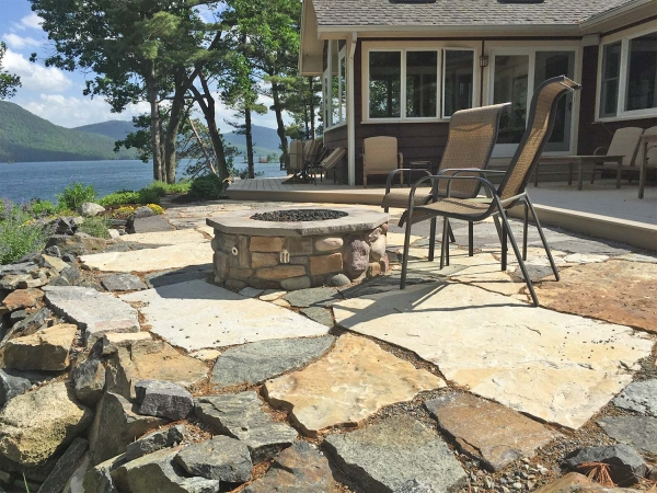 stone patio and firepit on lake george