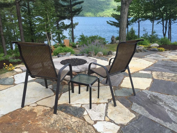 chairs around stone firepit