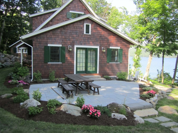 Patio with picnic table outside lake house