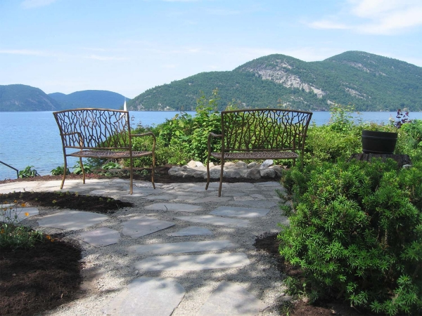 benches on patio overlooking lake