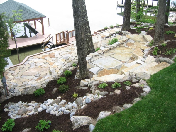 Stone patio, stairs and walls lakeside