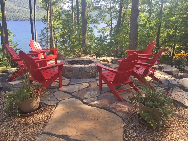 red Adirondack chairs around firepit