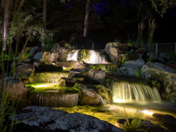 waterfall lit up at night
